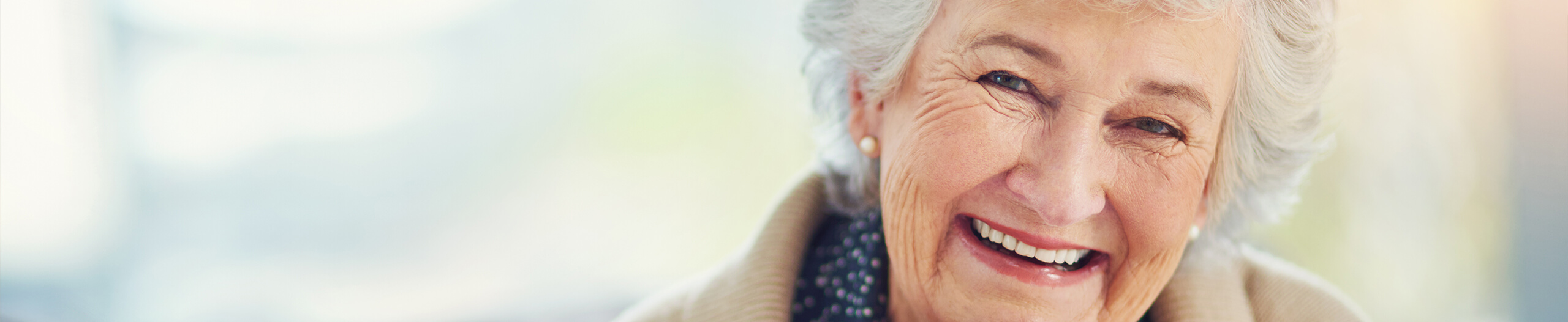Elderly woman smiling with dentures