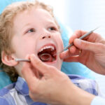 young boy getting a dental exam